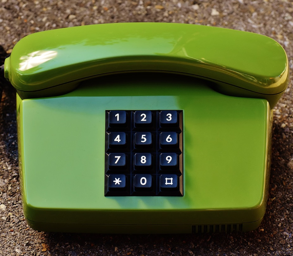 A photo of a green telephone.